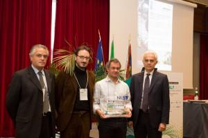 Nella foto, ai lati, Giuseppe Baldoneschi e Paolo Tirone (Rivoira). Al centro Francesco Rossella con Pasqualantonio Pingue (Laboratorio NEST)